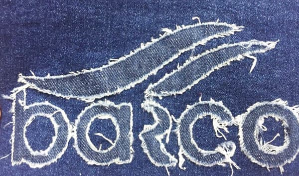 Text graphic decos on cotton jean